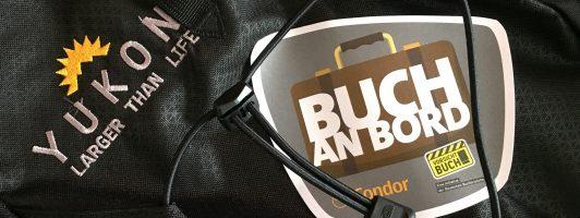Buch an Bord-Aufkleber auf einem Rucksack