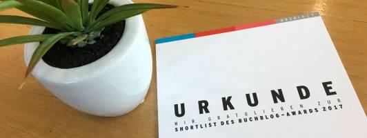 Eine Urkunde (mit Symbolpflanze) für die Shortlist-Kandidaten
