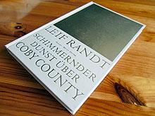 Cover: Schimmernder Dunst über Coby County