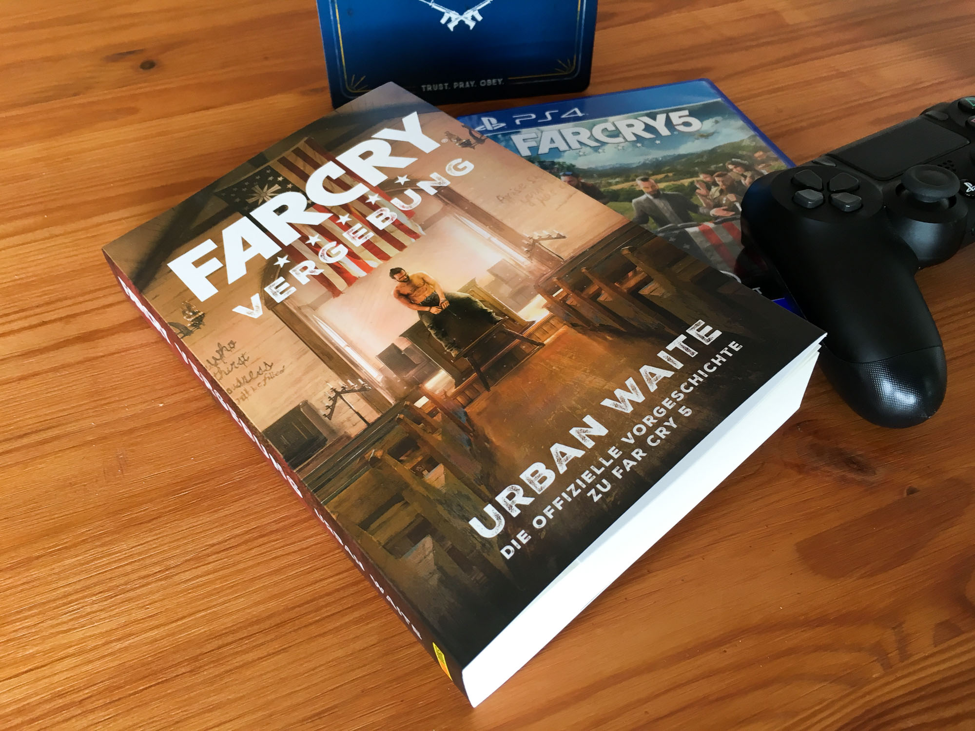 far cry 5 mit buch vergebung f r ein videospiel. Black Bedroom Furniture Sets. Home Design Ideas