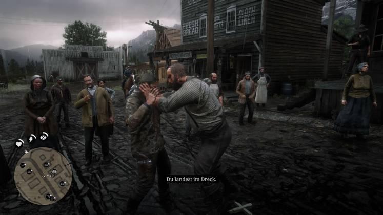Auf den schlammigen Dorfstraßen beginnt eine Schlägerei